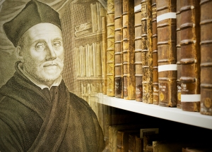 Portrait of Athanasius Kircher with some of our 17th century folio stacks.